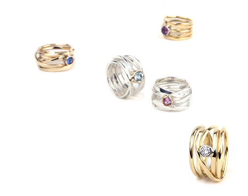 colored sapphires set in sterling silver and 18k gold rings