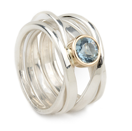 This pretty aquamarine, set in 18k yellow gold atop a sterling silver Onefooter ring, is at Compliments Gallery in Kennebunkport, Maine