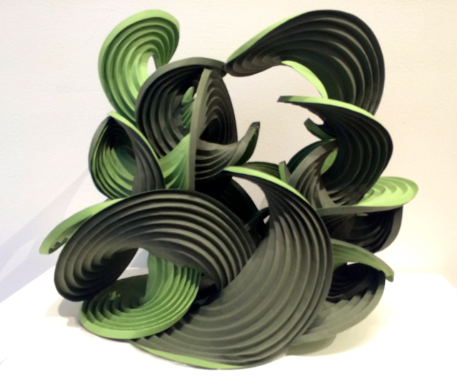 """""""Green Waterfall"""" is created from a series of logarithmically related circles on paper, each folded along a series of curved creases"""
