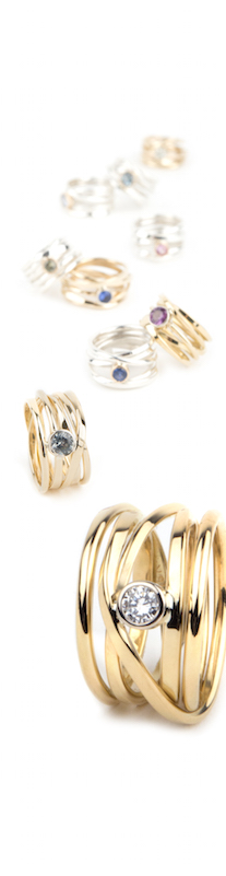 a sprawl of coloured sapphires and Canadian diamonds, set in sterling silver and 18k gold rings