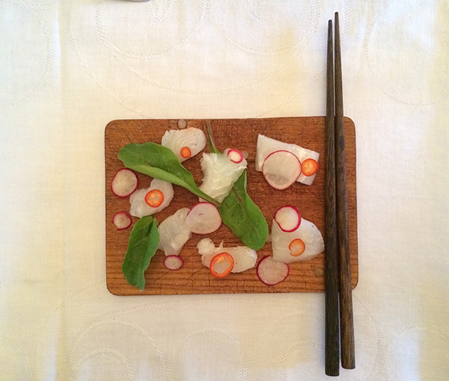Halibut crudo with Lemon Oil caviar, Radish, Thai chillies, Beet greens.
