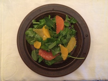 Salad with arugula and tarragon, mint, red onion,orange