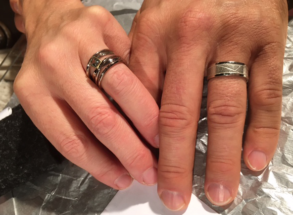 the happy couple with their custom made commitment rings