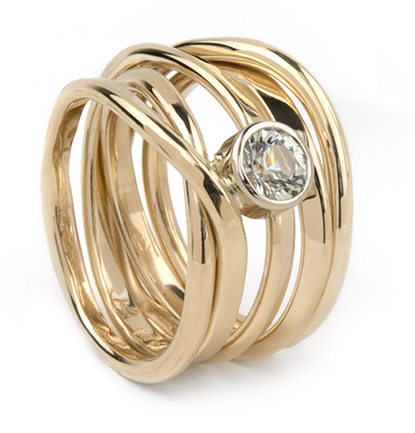 Again 14k, this ring has a almost colourless sapphire; size 6.5 and $2,640