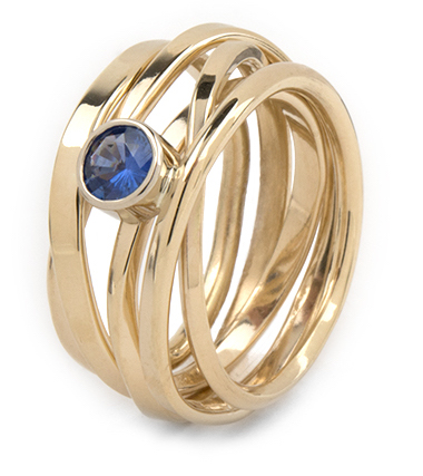 This 14k Onefooter ring is set with a dark blue sapphire. It is a size 8.5 $2,640