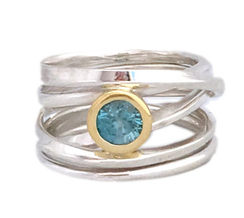 This sterling onefooter ring with a sparkling natural blue zircon set in 18k yellow gold bezel recently arrived at Human Arts Gallery in Ojai, California