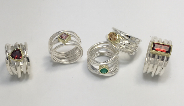 Some of the new Onefooter rings with gemstones I will be bringing with me to CircleCraft (left to right): trillion cut garnet, princess cut pink sapphire, natural emerald, oval imperial topaz, and garnet baguette