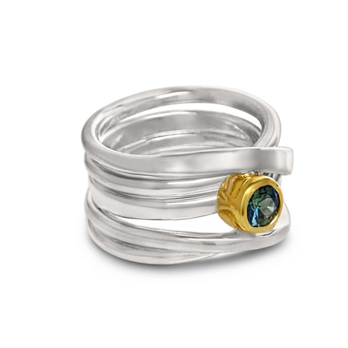 round Australian sapphire set in 18k yellow gold atop a sterling wrapring