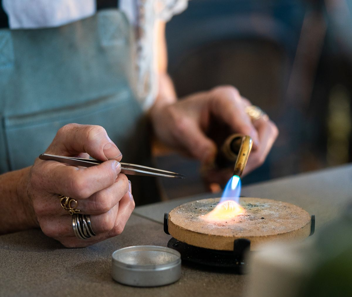 Dorothee Rosen on the bench in studio One of a Kind Sterling Silver rings